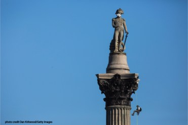 Gas mask customized with anchor and ship wheel as filters on Admiral Nelson in Trafalgar Square