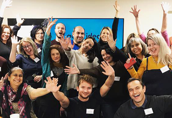 Good Ideas Camp 2018 - group of people smiling and cheering