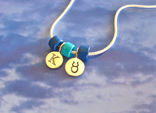 Camino necklace with Taurus zodiac disc and letter K