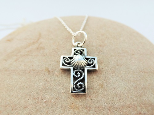 Silver cross with scallop shell