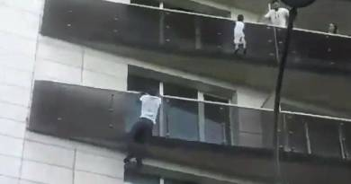 """""""Spider-Man,"""" a Migrant in Paris, Scales Building to Save a Child"""