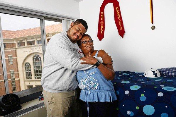 Tristan Baizar, Neighborhood Academic Initiative scholarship recipient, in his new dorm room, hugs his mother, Malva Yorke.