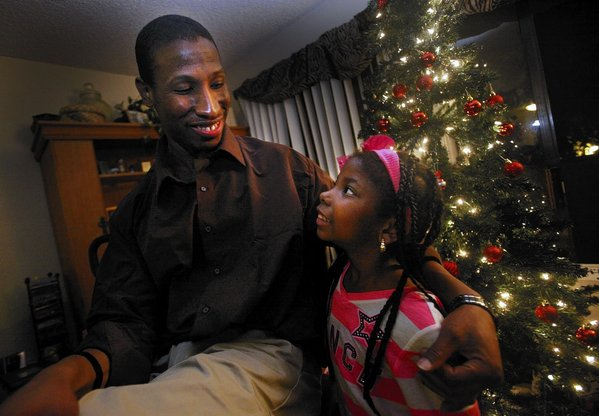 first evening as a free man with his niece Briana Brown, 7, step daughters, friends and family at his aunt Valdine Brown's home in Torrance on DECEMBER 21, 2013.  He spent a decade behind bars for a fatal shooting in 2002 but after filing appeals was found not guilty by a jury and released Friday evening.  ( Bob Chamberlin / Los Angeles Times )