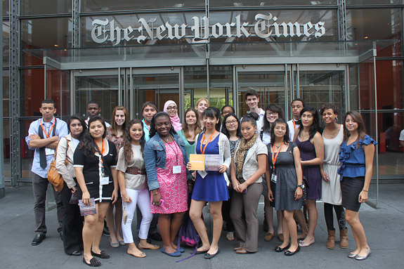 Members of the Summer Journalism Program pose for a photo at the entrance to The New York Times, one of several news organizations they visited during a visit to New York City. The students also visited CNN as well as Newsweek and The Daily Beast as part of the broad exposure they received on various forms of journalism. (Photo by Brian Rokus)