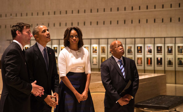 President Obama, with Michelle Obama, the library director, Mark K. Updegrove, left, and Representative John Lewis. (DOUG MILLS/THE NEW YORK TIMES)