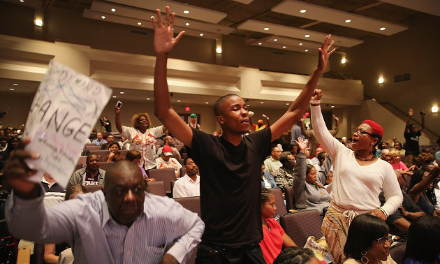 Residents during the Ferguson city council meeting on September 9, 2014 in Ferguson, Missouri.   (Photo by Scott Olson/Getty Images)