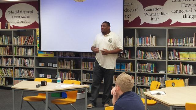Jacksonville Jaguar Red Bryant Speaking to R.L. Brown Elementary School's GRASP Choice Academy