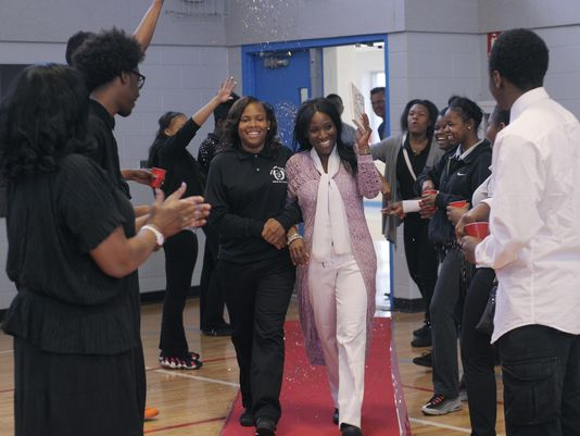 A'Ja Booth, left, and teacher Nadirah Muhammad are honored with the red carpet treatment by their West Side Academy peers as they enter the gym Tuesday. Muhammad was motivated to get tested as a potential donor when she found out A'Ja needed a new kidney. (Photo: Photos by Clarence Tabb Jr. / The Detroit News)