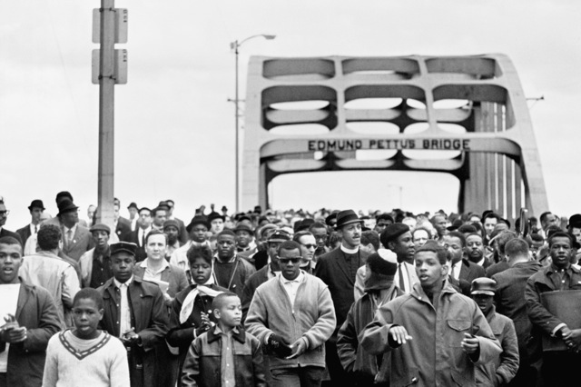 Photo Credit: Flip Schulke/Corbis – Civil Rights March Across Edmund Pettis Bridge. Civil rights activists march across the Edmund Pettus Bridge, starting the second march to Montgomery. In the first march, the marchers had been attacked and beaten by Alabama state troopers and local law enforcement. Only the third march actually made it all the way to Montgomery. March 9, 1965