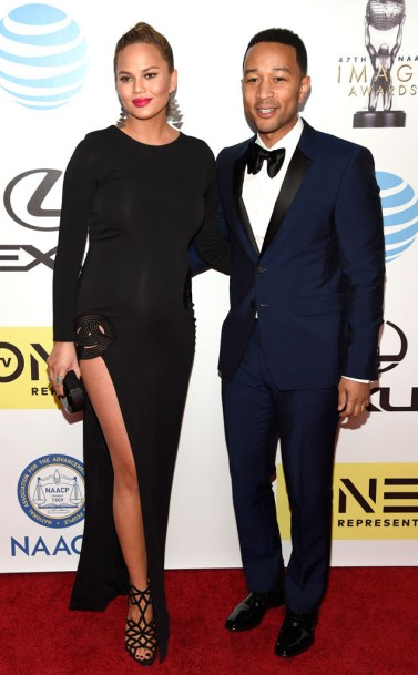 Chrissy Tiegen with husband and NAACP President's Award winner John Legend (photo via eonline.com
