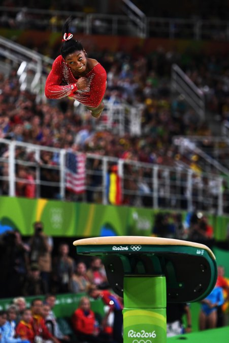 Simone Biles flying high during  Olympic Vault finals in Women's Gymnastics (photo via nytimes.com)