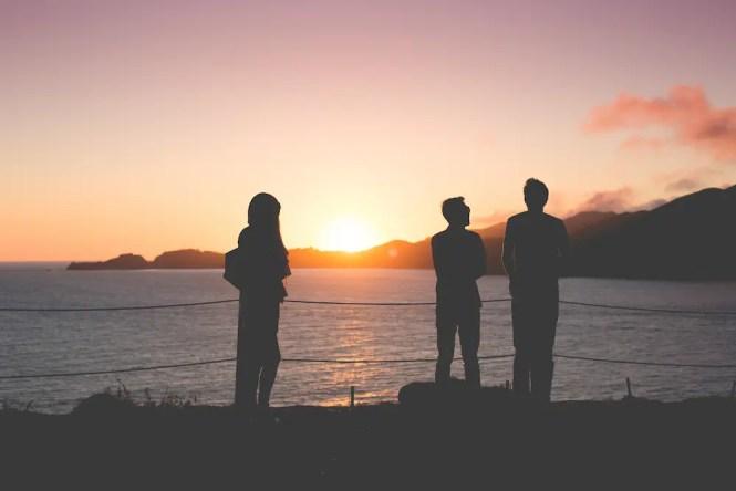 people-enjoying-sunset-over-the-ocean-picjumbo-com