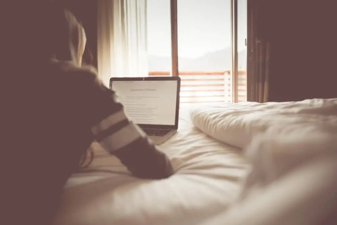 girl-reading-a-blog-in-a-bedroom-picjumbo-com-2