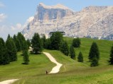 One of the Alta Badia peaks above San Cassiano, towers over the path.
