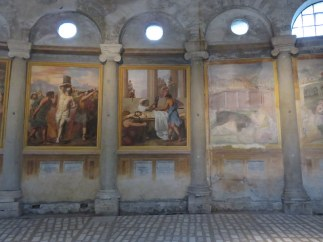 Some of Santo Stefano's many frescoes are in the process of being restored.