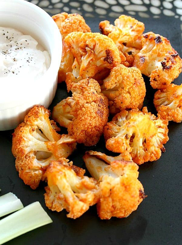 Cauliflower buffalo bites with blue cheese dressing on the side