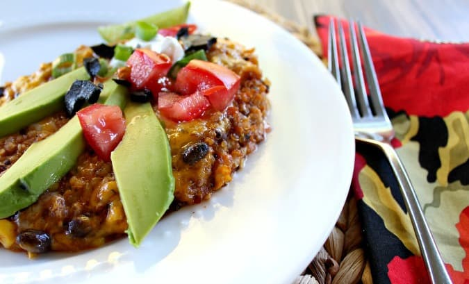 Quinoa Black Bean Enchilada Casserole. Perfect for a meatless weeknight meal and unique enough for company, loaded with healthy protein and vegetables.