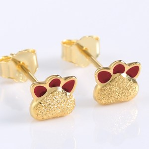front view silver with gold plate paw earring
