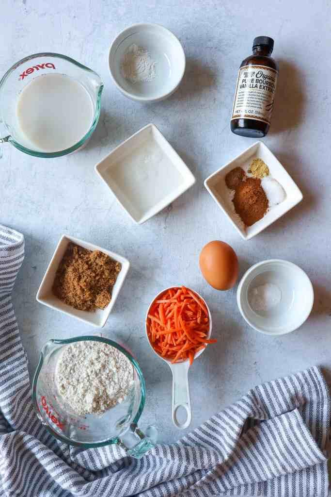 Ingredients needed to make carrot cake pancakes: almond milk, baking powder, vanilla extract, coconut oil, cinnamon, ground ginger, nutmeg, salt, brown sugar, egg, carrots, gluten-free all purpose flour
