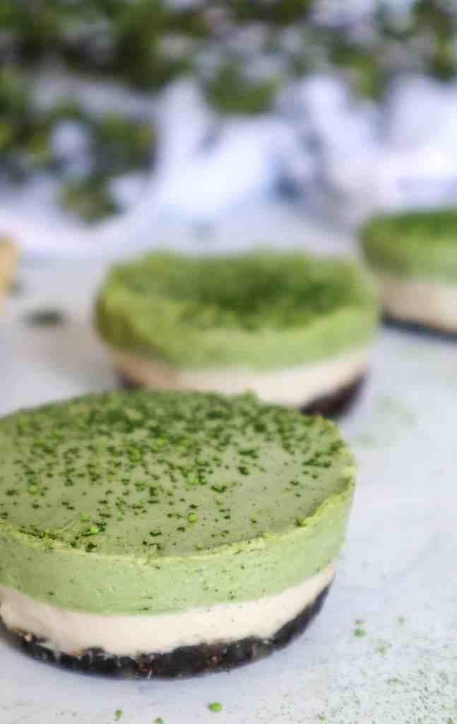 A close up image of Mini Matcha Cheesecakes