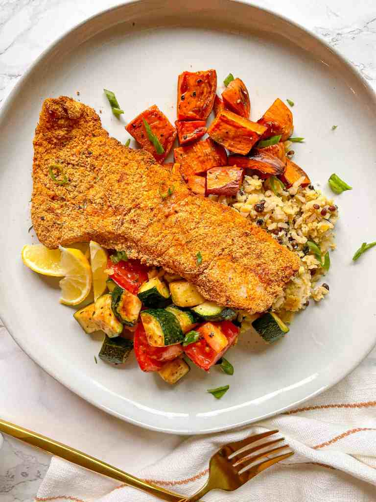Crispy Gluten-Free Air Fryer Fish served over rice with potatoes and vegetables