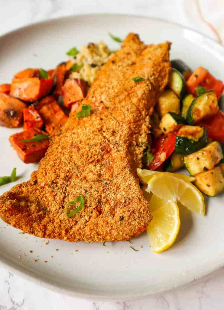 Crispy Gluten-Free Breaded Air Fryer Fish served over rice with potatoes and vegetables