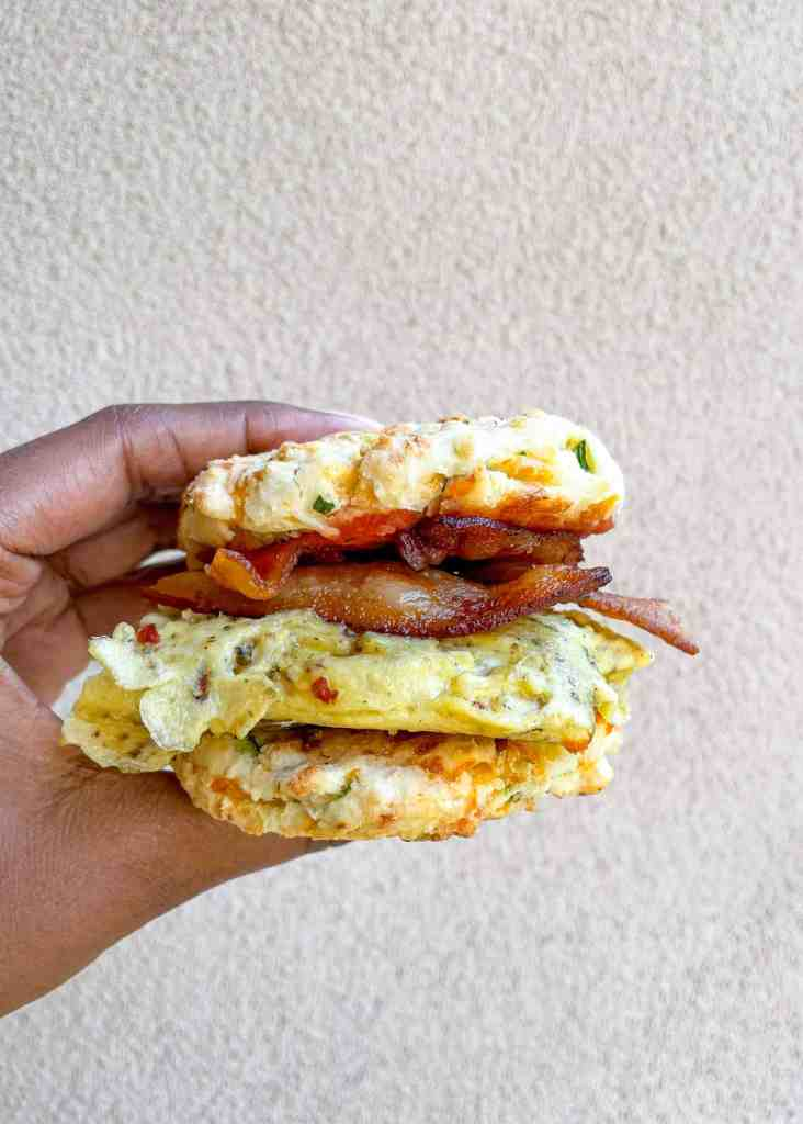 Breakfast sandwich using gluten free biscuits, eggs, and bacon