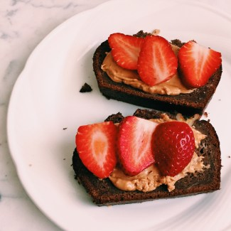 Two Clean Kids' choc banana bread with almond butter and fresh strawberries