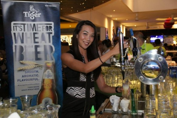 Jessie Chuah, Tiger Beer marketing manager tapping Tiger White