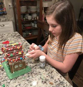 She had fun making her own Gingerbread House