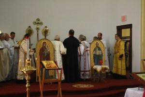 Hierodeacon Vasyl and Deacon Paul lead Subdeacon Michael into the altar for ordination.