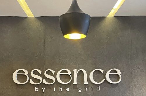essence by the grid signage