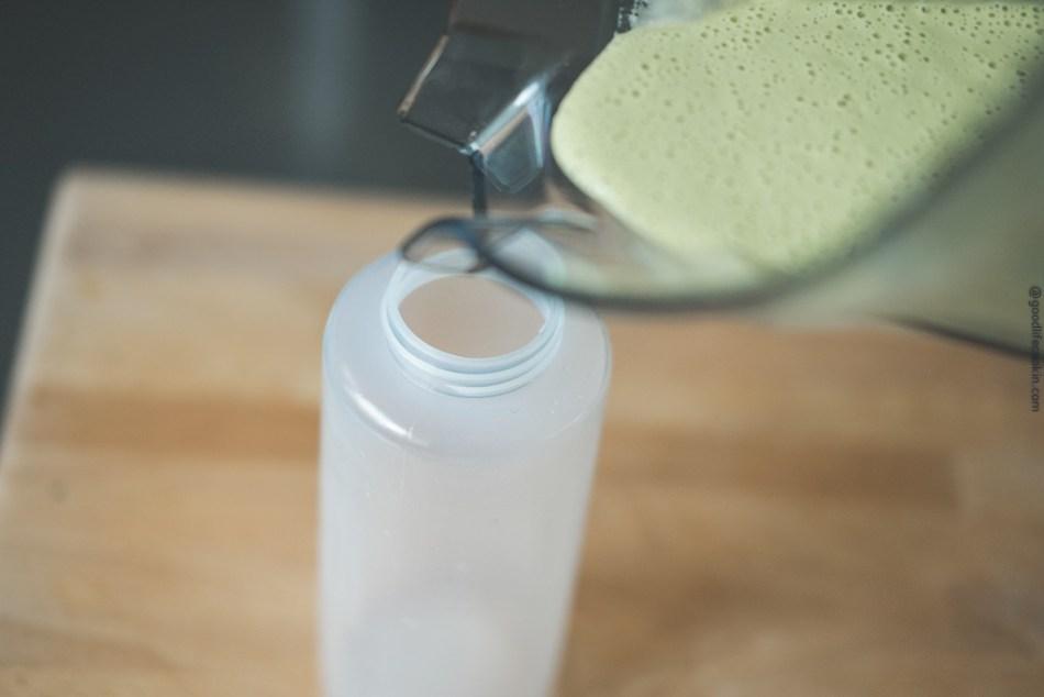Creamy basil green dressing pour