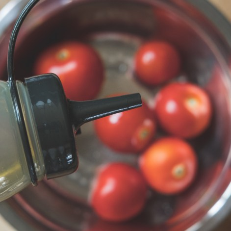 olive oil over tomatoes