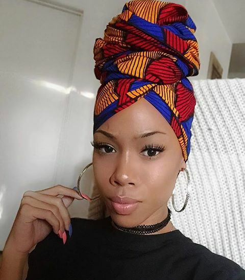 "Beautiful African headwrap styles like the ""bun on top"" look can be dressed up or down for any type of occasion!"
