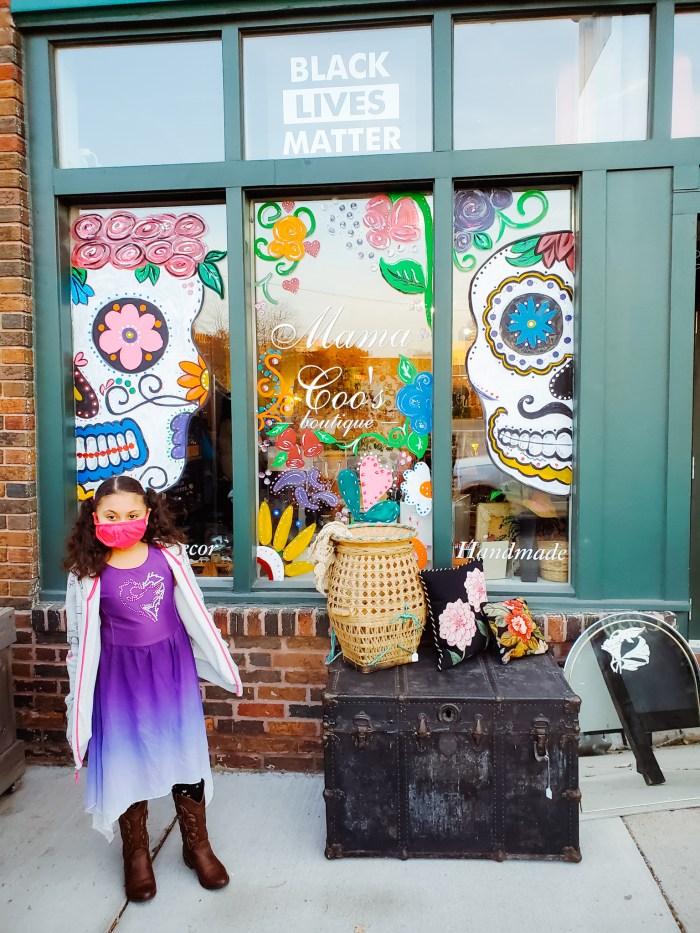 Día de Los Muertos Ofrendas window art at Mama Coo's Boutique in Detroit, Michigan.