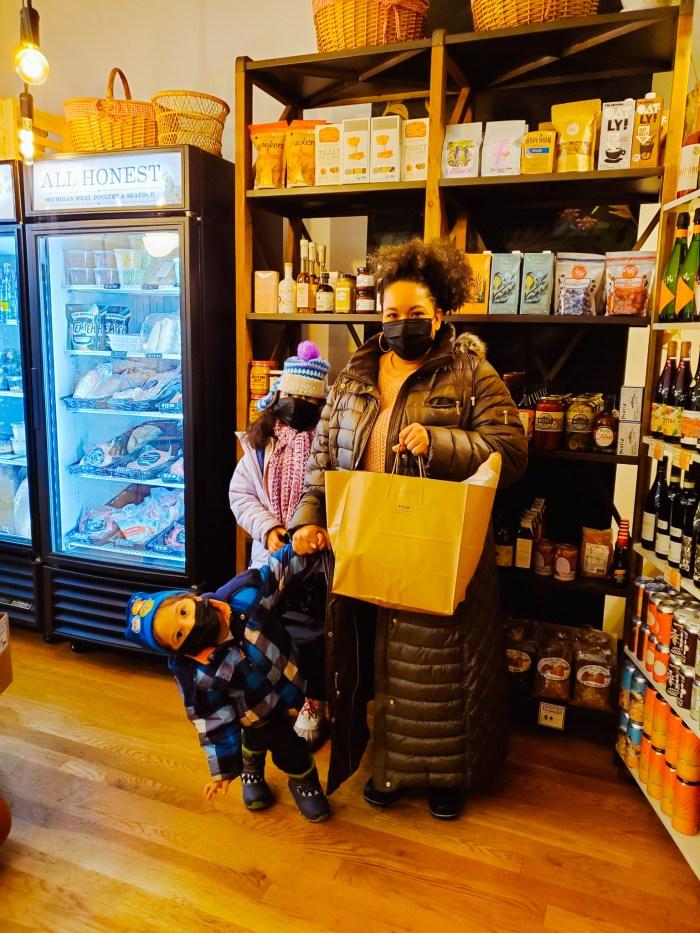 A family shopping at Folk Detroit farm market