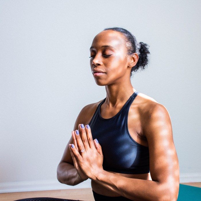 Why Black Mental Health Matters Now More Than Ever (Image of a Black woman practicing yoga)