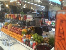 A juice vendor's stand. So many delicious fruits and veggies