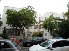 This is a common style of building in Tel Aviv. It is two apartment buildings attached with a courtyard in the middle. It is said that the Bauhaus movement was influenced by the cubist movement and you can see the influence in the shape of this building.