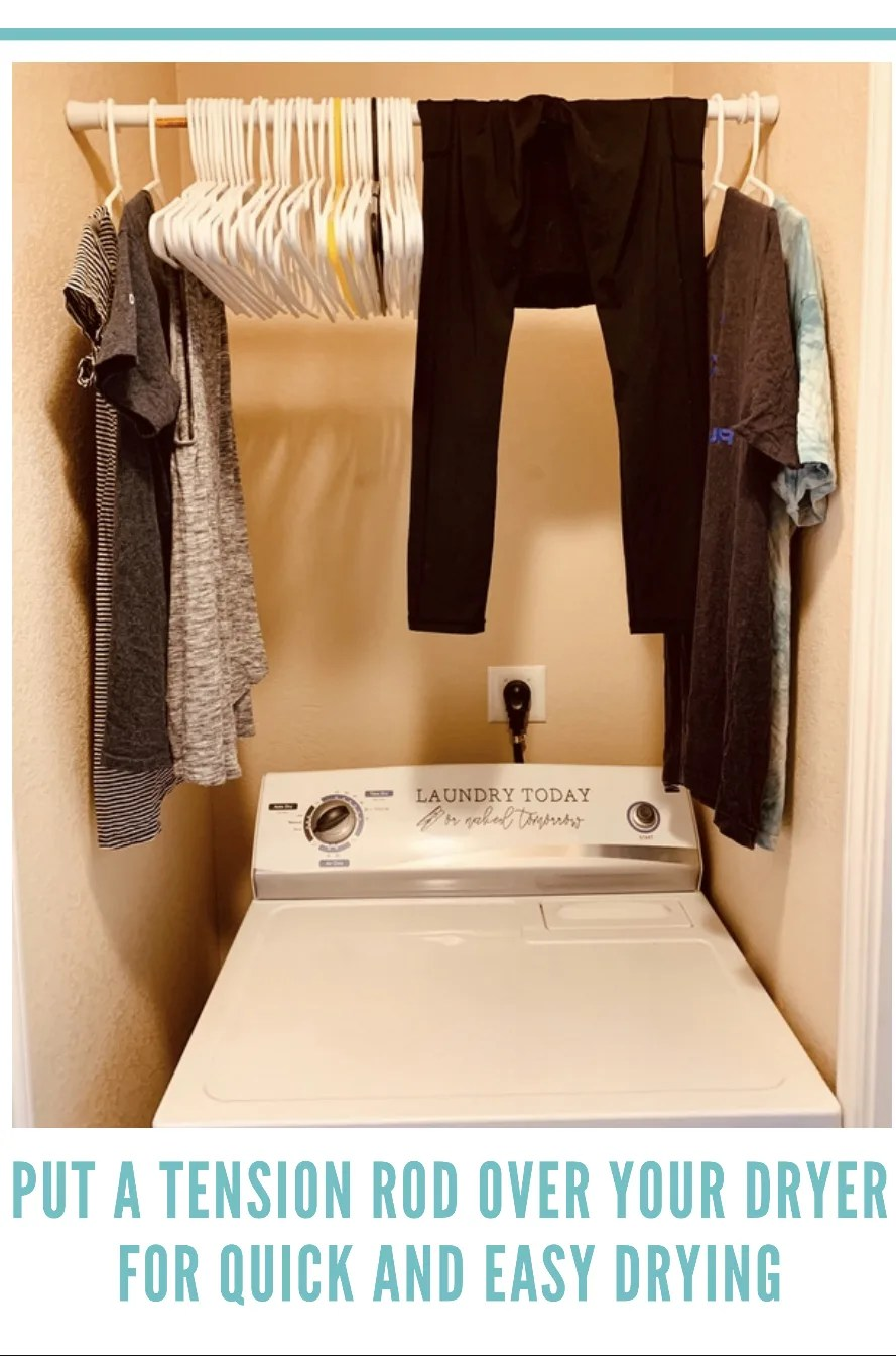 Put a tension rod over your dryer to quickly hang up laundry