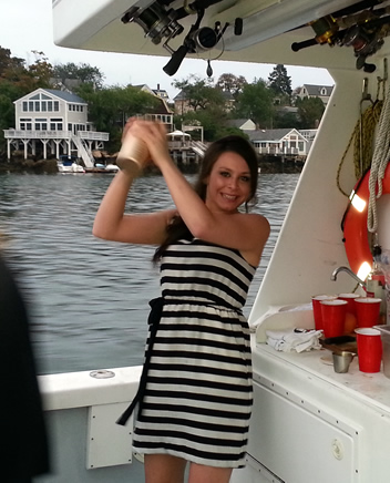 Alchemy mixologist Felicia Grossi mixes her signature cocktail on a tuna boat
