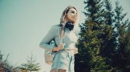 Mixcder E7 - lifestyle photo headphones on neck2