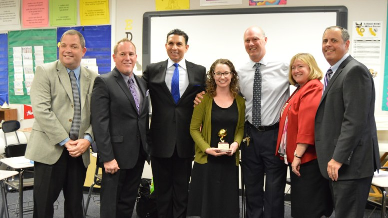 El Dorado High School teacher of the year with district administrators.