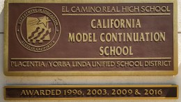 El Camino Real High plaque on the front of the high school.