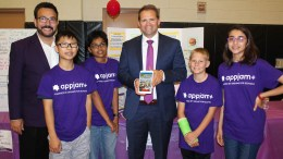 Principal Keith Carmona and teacher Shane Twamley pose with Kraemer Middle School's AppJam+ team, Snacker Hackers, in the El Dorado High School gymnasium. Later that evening, Team Snacker Hackers won first place in PYLUSD's AppJam+ Spring 2018 Showcase Finale!