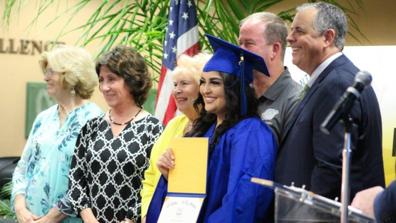 Graduate Johanna Rodriguez from El Camino Real High School proudly holds her newly earning high school diploma with PYLUSD Trustees and Dr. Greg Plutko at the first-ever Summer Graduation Ceremony on August 21, 2019.
