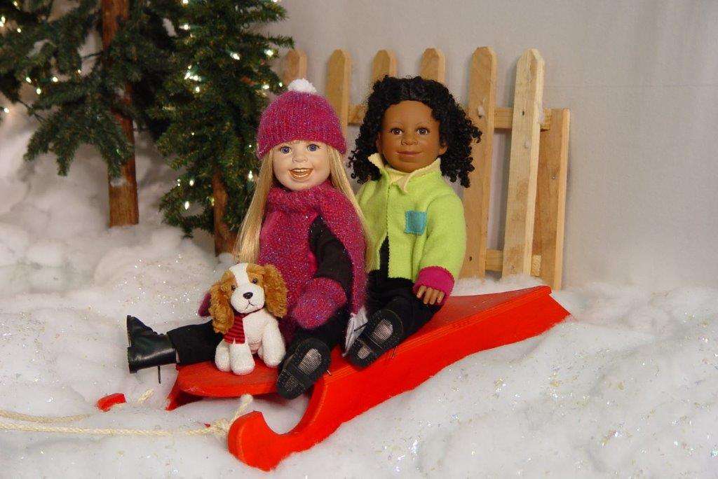 Closeup of the girls sledding
