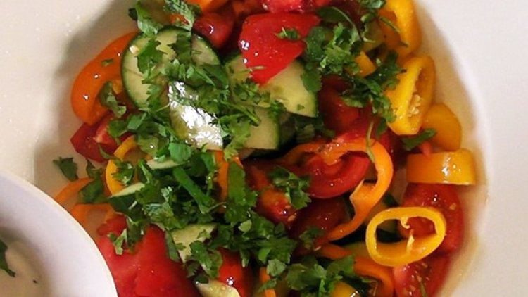 healthy summer salad made from garden vegetables: peppers, tomatoes, cucumbers and purple onions