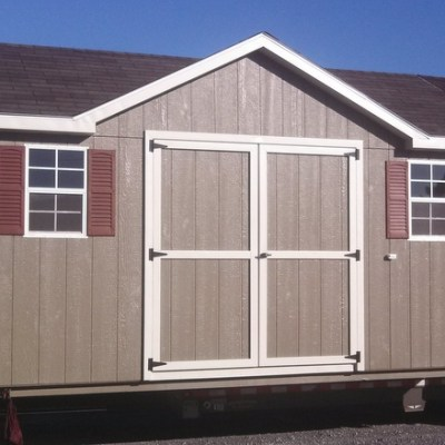 12 x 16 Painted Classic W Dormer (mo# 234) Siding color is Clay with Silver mist Trim Shingles are Driftwood and Shutters Brown. Has Upgraded LP Pro-Struct Flooring, 2 8x8 Gable vents and 12' Workbench. $4,077.05